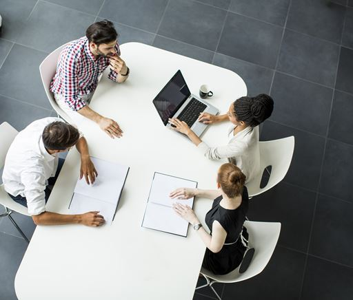 People sitting on a meeting table